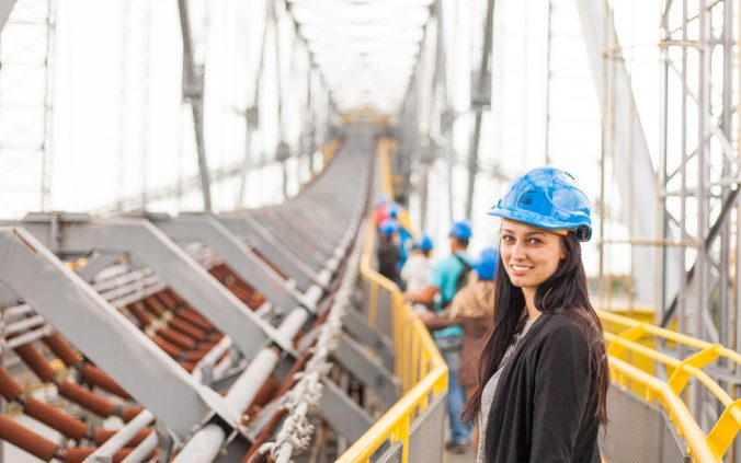 Girl wearing hard hat in construction zone